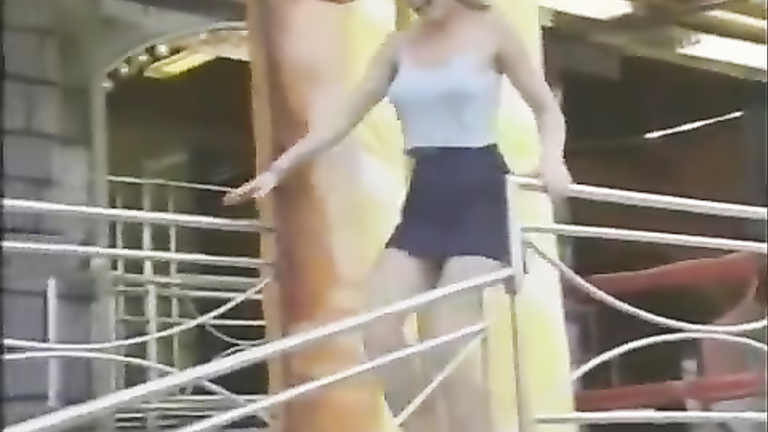 Gust of air picks up a delicious blonde's blue dress