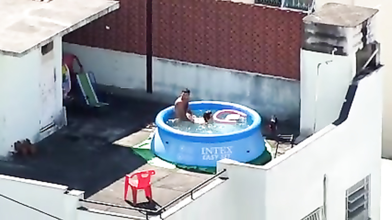 Neighbors having sex in pool