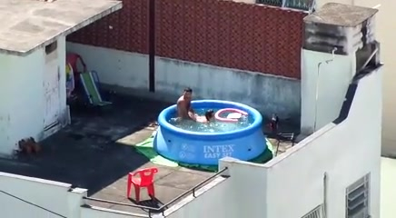 My horny neighbors caught having sex in the pool