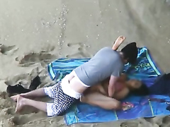 German macho man bangs his new girlfriend on the beach