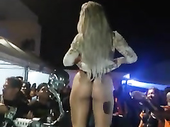 Mind-blowing blonde reveals her body on the bike show