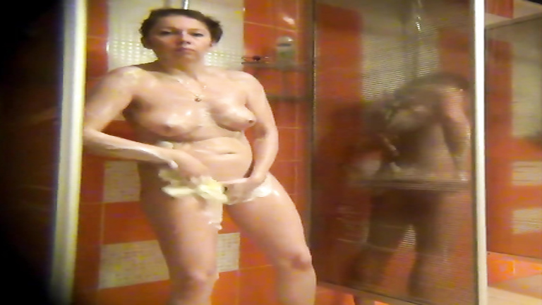 Curvaceous mommy enjoys a long relaxing shower