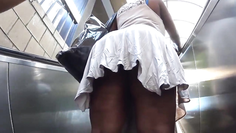 Smoking hot ebony lady with big booty walks around in a short dress