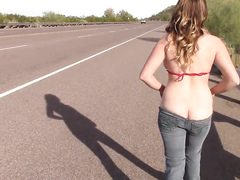 Busty babe takes the erotic walk down the highway