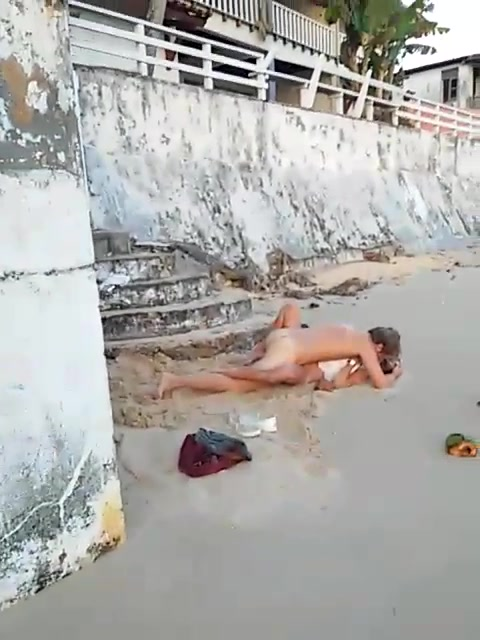 Missionary pounding on the sandy beach