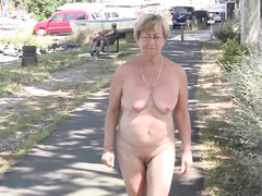 Mature woman enjoys walking around completely naked