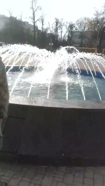 Hottest coed girl takes a bath in a fountain