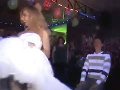 Foxy slim blonde performs a sensual striptease in a wedding dress