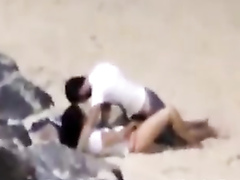 Italian lovers having missionary sex on the beach
