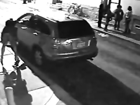 NYC prostitute hides behind a big car to relieve her bladder