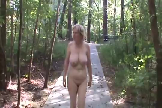 Brave blonde takes a naked walk in the woods