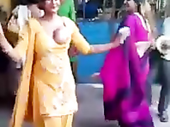 Stunning Indian woman dances around with one of her tits out