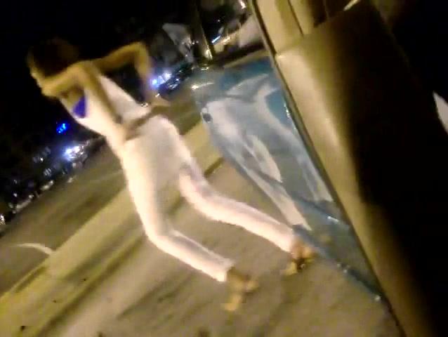 Black goddess urinates by the car