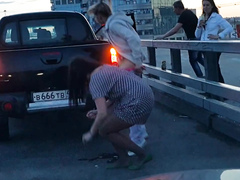 Russian chick shields her friend while she is peeing in the street