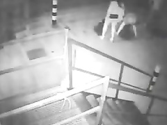 Two drunk girls get caught on security cam pissing really hard