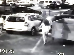 Surveillance camera films the desperate girl taking a piss