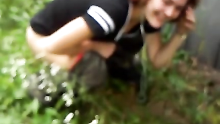 Naughty coed gets caught on tape peeing in the grass
