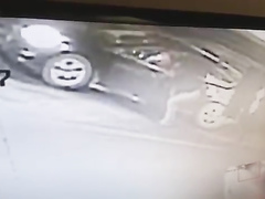 Desperate damsel urinates next to her car