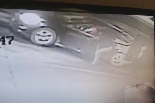 Desperate damsel urinates next to her car
