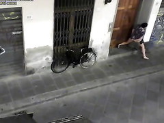 Desperate prostitute pisses in front of someone's doors