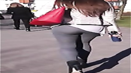 Huge bubble butt bounces around in tight grey leggings