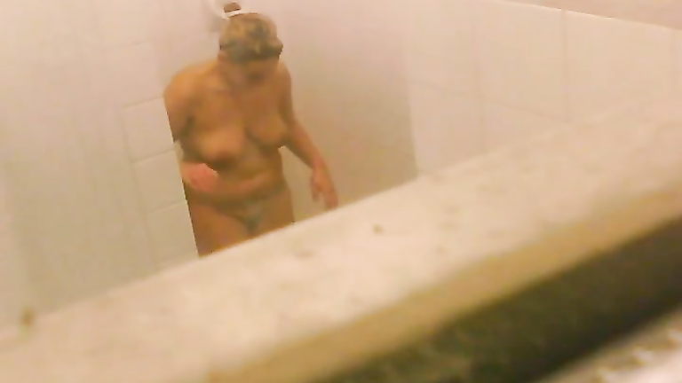 Chubby girls filmed while taking a shower