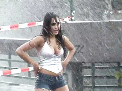 Stunning Latina babe has fun dancing in the rain
