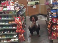 Wicked black girl decides to urinate in the supermarket