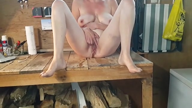 My slutty wife makes her wet pussy spray pee in my workshop