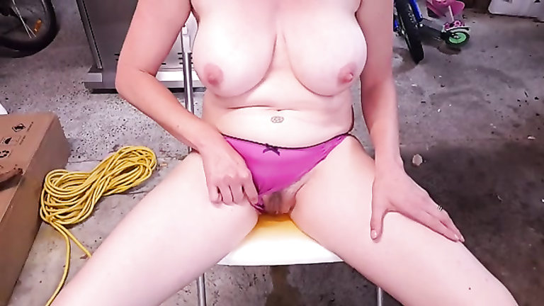 Kinky housewife takes a pee while sitting on a chair