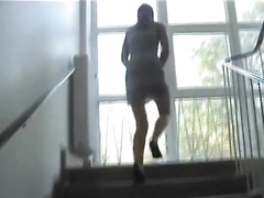 Naughtiest chick ever takes a piss from a window!