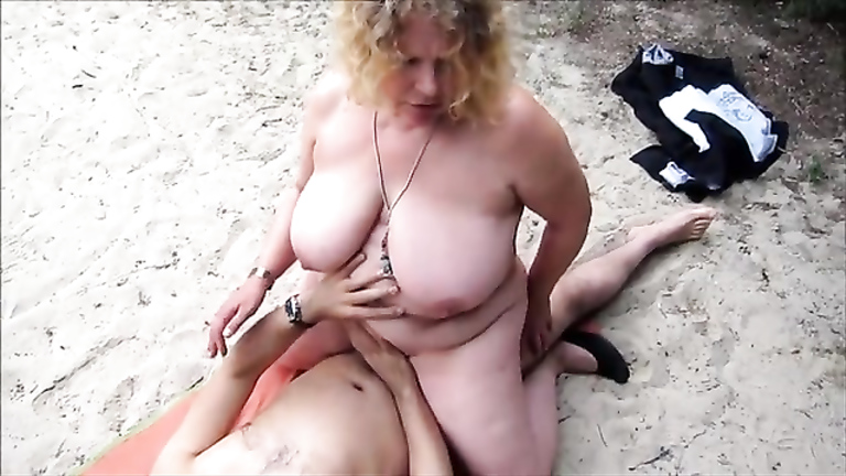 My large-breasted wife rides on a friend's throbbing cock