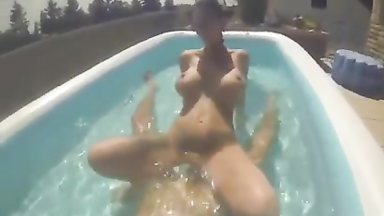 Flamboyant girl-next-door rides the dick in the rubber pool