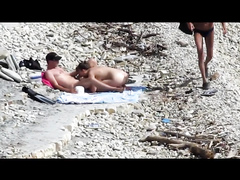 Sensual girl jumps on her boyfriend's fat dick at the nude beach