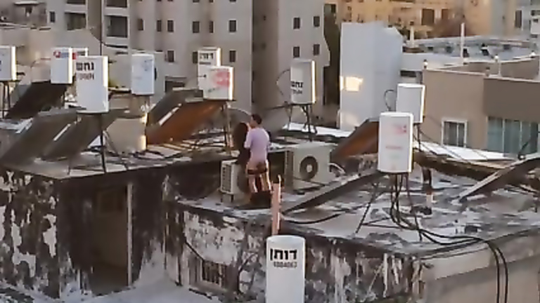 Turkish couple copulates on the top of their building