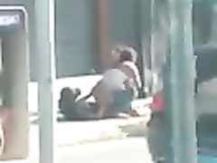 Black guy bangs a Brazilian prostitute on the middle of a sidewalk