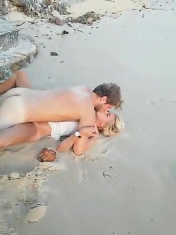 Drunk blonde enjoys having her pussy rammed on the beach
