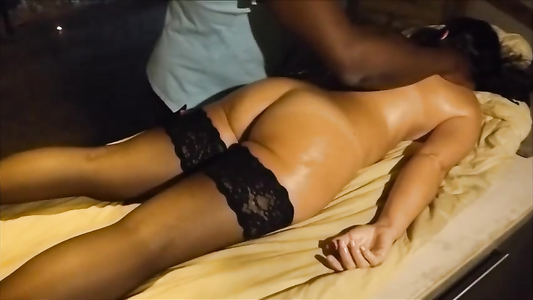 My hot wife in stockings has her large buttocks massaged by a black master