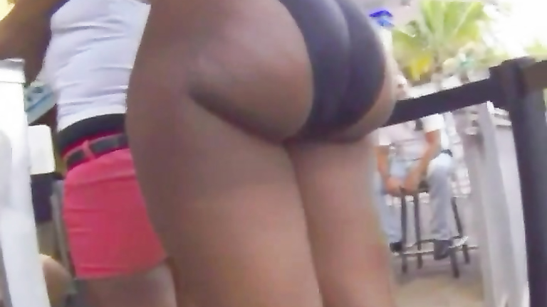 Curvaceous Brazilian goddess has her big butt recorded from behind