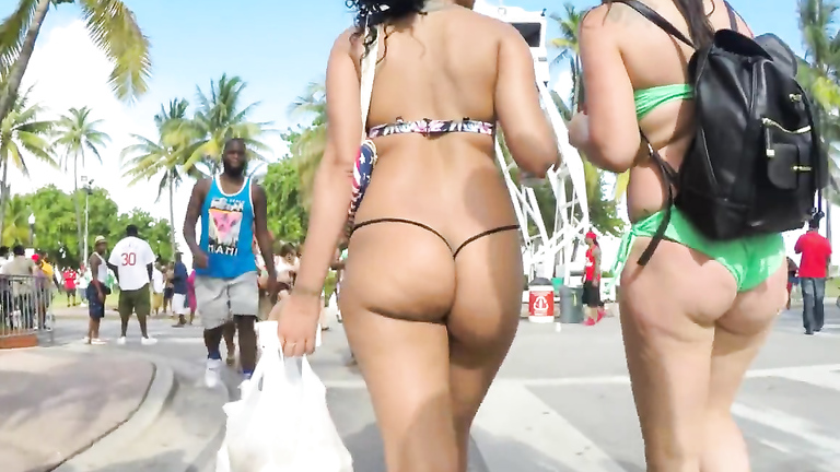 Two bootylicious hotties get taped from behind while wearing bikinis