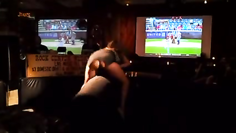 Stacked blonde bombshell rides a mechanical bull in the sport bar