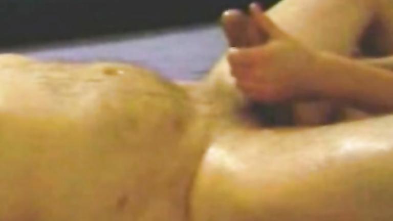 Asian woman enjoys tugging hard on a throbbing dick