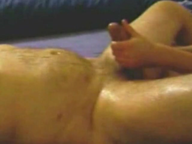 Asian woman enjoys tugging hard on a throbbing dick