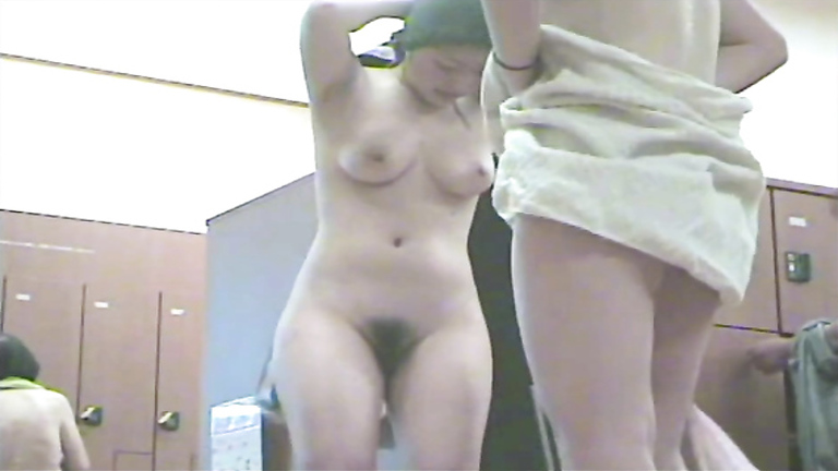 Luscious Asian maid shows off her hairy pubis and big natural boobs