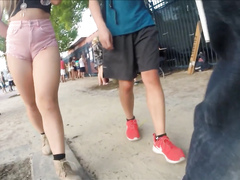 Voluptuous hoochie walks around the crowd in pink shorts