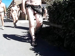 Mature nudists walk around the beach town completely naked