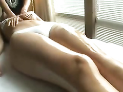 Stunning slim filly in a bikini receives a sensual massage