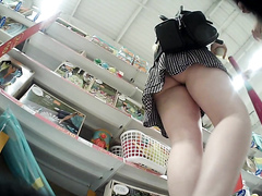 Voluptuous mommy has her panties recorded in a store