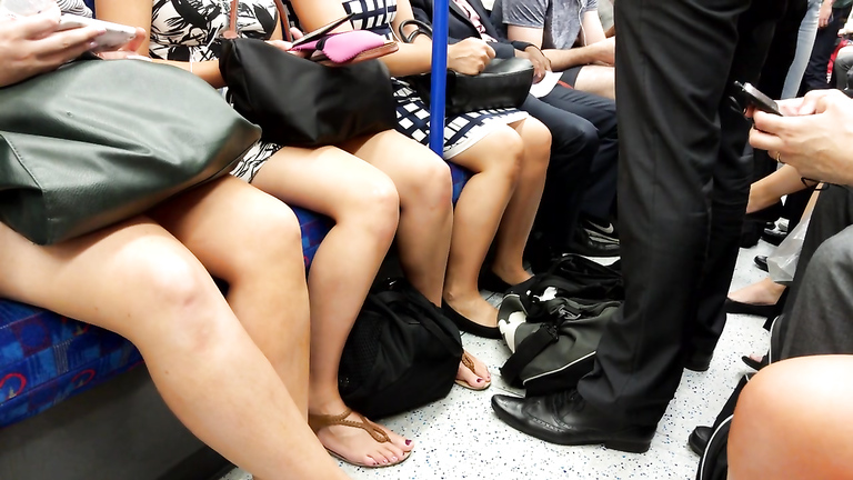 Group of sexy ladies in short skirts have their tasty legs recorded in the subway