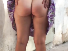 Foxy girlfriend spreads her pussy lips on a chair outside